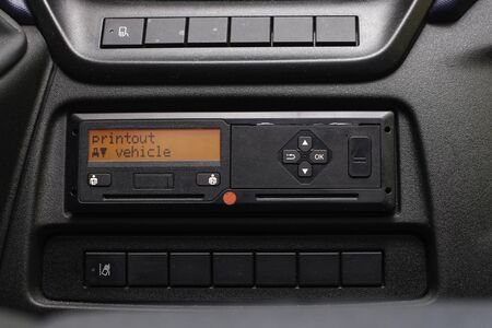 Digital tachograph display reads Printout Vehicle. No personal data. Tachograph in a van. 免版税图像