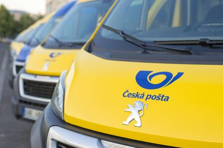 Olomouc Czech Rep 23th July 2019 yellow Czech Post Office vans parked in a line. Lined up Peuegeot Boxer vans of Cesk Posta. Detail of the Czech Post office logo.