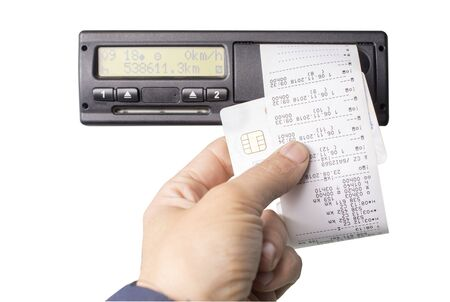 Digital tachograph and drivers hand holding print with driving times of the day. Isolated on white background. No personal data