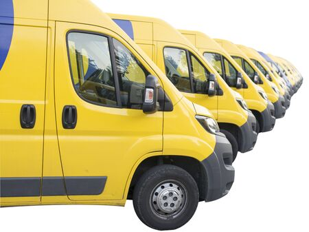 Yellow vans lined up and parked in a long row isolated on white background. Delivery trucks fleet