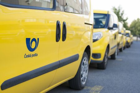 Olomouc Czech Rep 23th July 2019 yellow Czech Post Office cars parked in a line. Lined up pick-ups cars of Cesk Posta. Detail of the Czech Post office logo. Fiat Doblo fleet.