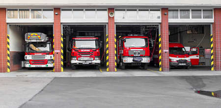 Prostejov, Czech Rep, Aug 14th 2017. Red fire fighter trucks parked in open garage. Fire brigade of the Czech republic. Firefighter special vehicle