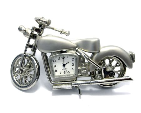 Desktop hours - a motorcycle on a white background Stock Photo - 3259674