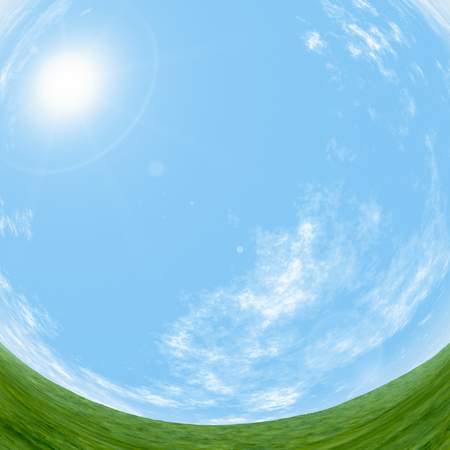 fish eye: panoramic view of the blue sky and the green plain with effect a fish eye