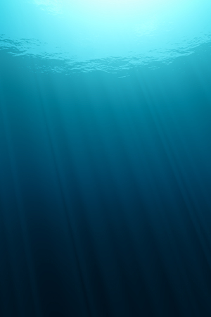depth: View from underwater with beams of the sun.