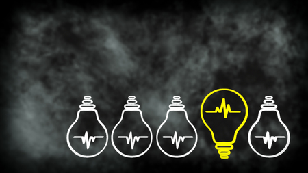 differs: the concept of new idea, one bulb differs from the others, on a dark, indistinct background Stock Photo