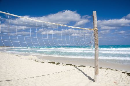 volleyball net on a empty sunny beach photo