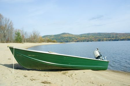 green boat: a small green boat near the shore