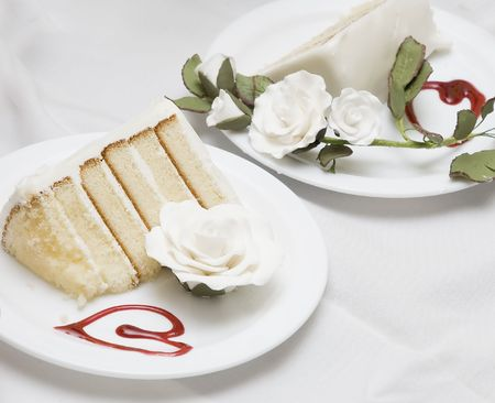two pieces of a wedding cake on different plates photo