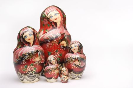 Colorful russian nesting dolls isolated on a white background photo