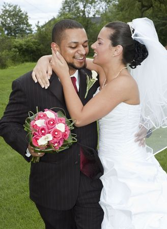 Just married multi ethnic couple having fun and laughing 스톡 콘텐츠