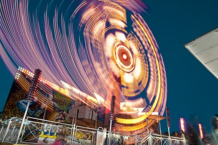 blurs and color effects created by rides at the amusement park