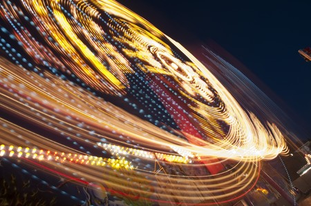 blurs and color effects created by rides at the amusement park  photo