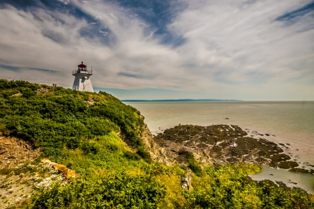 enrage: Lighthouse of the eroded cliff and beach located in Cape Enrage New Brunswick Canada
