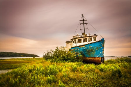 abandonned rusty boat located on a panoramic route to Halifax Nova Scotia Canada