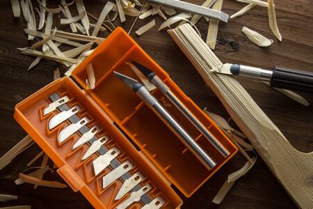 A set of knives for cutting wood lies on a table in a pile of chips. Stock fotó - 138273800