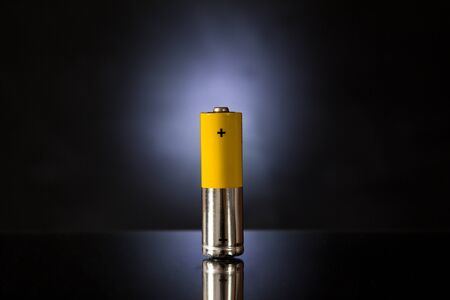One yellow-silver battery with a black backlit Stok Fotoğraf