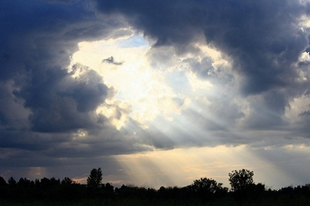 breaking: the suns rays breaking through the storm clouds