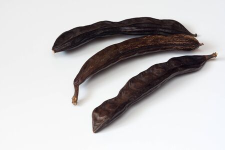 carob fruit pods on a white background isolated