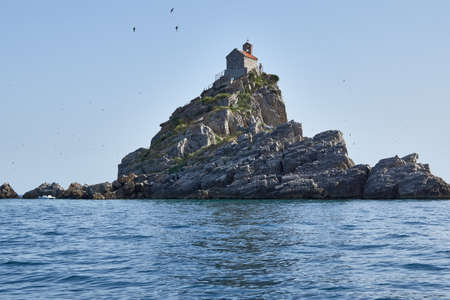 Small stone Islands in the sea with a small chapel on top