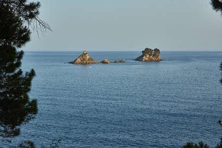 Small stone island in the sea near Petrovac Фото со стока