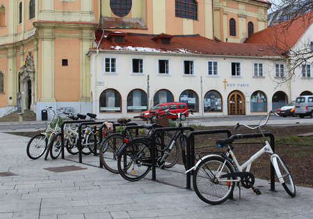 Transport in the city - bicycles parked in front of historical buildings in the centre of Bratislava, Slovakia