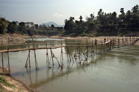 Bamboo bridge over the river Redakční