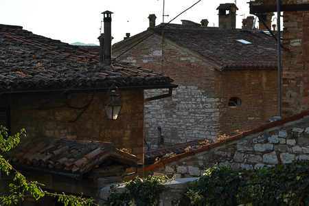 street lamp: Historic houses with lanterns and ivy-covered walls in the central mountains in Italy Stock Photo