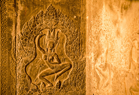 Wallpaper decorated with ornament in Angkor Wat temple with sunset evening in Cambodia