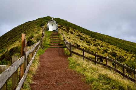 the path along the crest of the volcano to the chapel on the island of the Azores Stock Photo