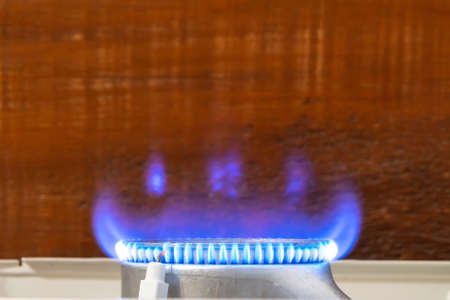 Blue flame of natural gas in a kitchen stove