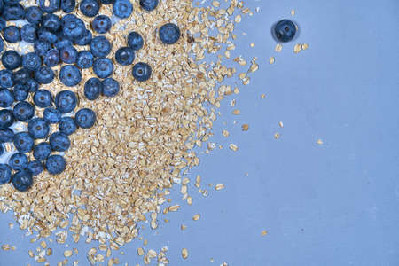 Blueberries and bunting background. snack. muesli. plate heart. with love.