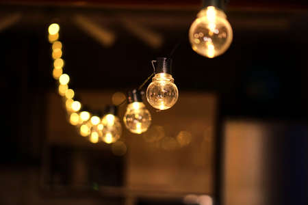 Christmas garland with golden lamps. Edison for the holiday. Cozy lights.