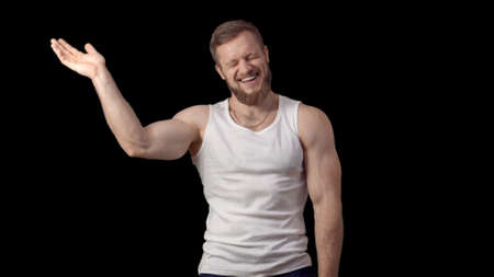 man laughed unexpectedly. Caucasian man with beard in a shirt smiles and claps.
