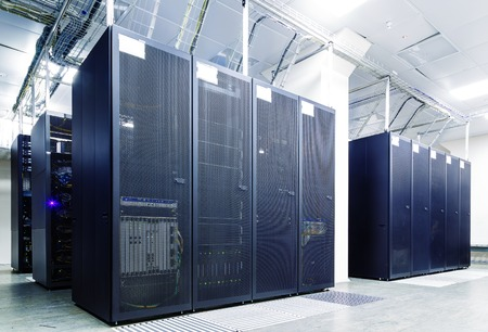 hardware: room with rows of server hardware in the data center Stock Photo
