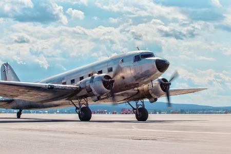douglas: Dakota Douglas C 47 transport old plane boarded on the runway summer Stock Photo