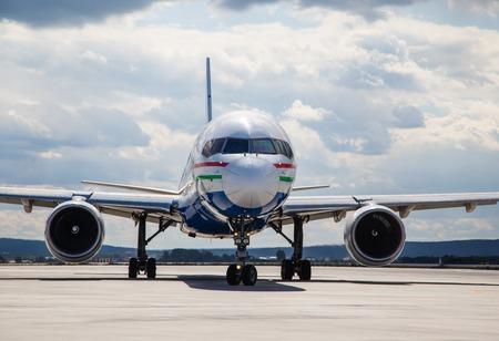 air plane: modern aircraft on the runway summer