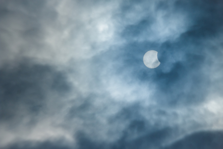 moon and stars: Partial Solar Eclipse on a Cloudy Day 20.03.2015 Stock Photo
