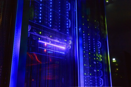 mainframe: mainframe in dark room with illumination from the server hardware Stock Photo