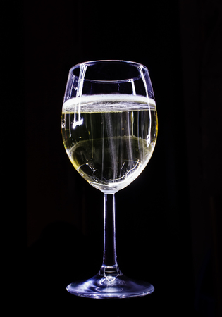 long exposure: champagne glass long exposure low key black background