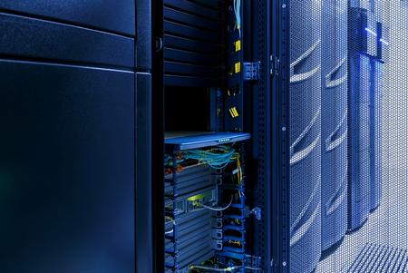 rack arrangement: inside server room with rows of modern mainframes Stock Photo