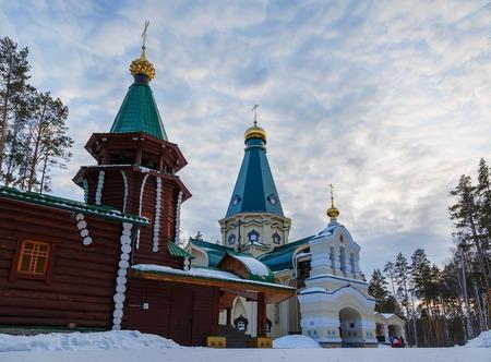 kingly: wooden church in woods in winter Ural Ekaterinburg Ganin Yama