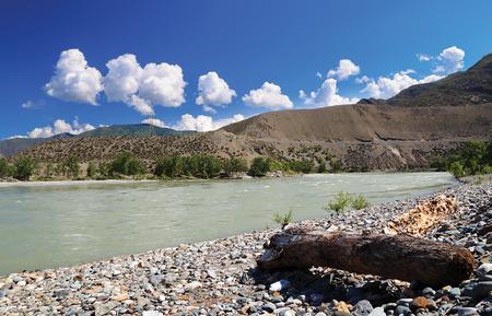 katun: mountain river shore stones sunny day Mountain Altai Katun