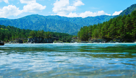 katun: view from below water surface Katun river Altai Mountains summer sunny day, Russia