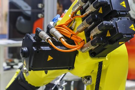 parts of a yellow modern industrial robot closeup