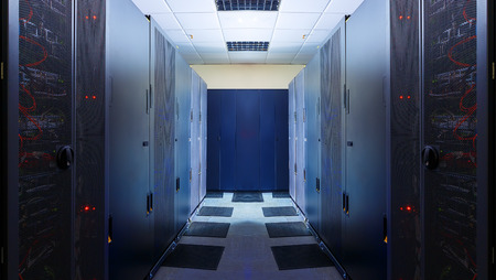 in the ranks: modern server room symmetry ranks supercomputers with light Stock Photo