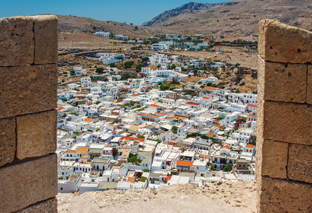 loophole: view of ancient city of Lindos by loophole ancient fortress
