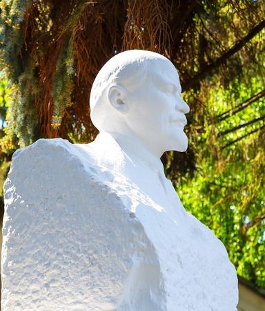ulyanov: plaster bust of Lenin on background of green summer sunny weather Stock Photo
