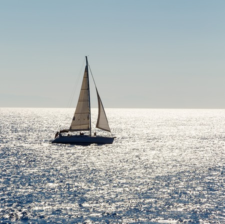 mongo: Sailing ship yachts with white sails in open sea