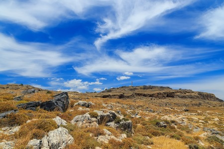 igneous: Mountain clouds igneous rock sunny day Greek Stock Photo